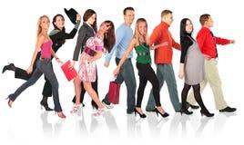 Grupo de passeio dos povos no branco Imagens de Stock