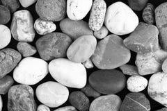 Grupo de pedras em um fundo preto Fotos de Stock Royalty Free