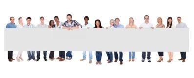 Grupo de personas con el cartel Foto de archivo