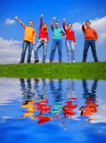 Grupo de personas con los pulgares para arriba Foto de archivo libre de regalías