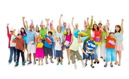 Grupo de personas diverso en un partido Imágenes de archivo libres de regalías