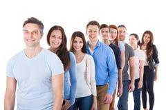 Grupo de personas diverso que se coloca en fila imágenes de archivo libres de regalías