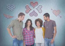 Grupo de personas en los pares que se colocan delante de iconos del corazón del amor Imagenes de archivo