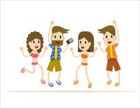 Grupo de personas feliz que salta en la playa Imagen de archivo libre de regalías