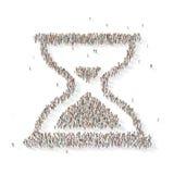 Grupo de personas grande en la forma de un reloj de la arena Fotos de archivo