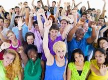 Grupo de personas grande que celebra Imagen de archivo