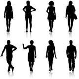 Grupo de personas negro de la silueta que se coloca en diversas actitudes stock de ilustración