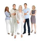 Grupo de personas ocasional que se coloca sobre blanco Foto de archivo libre de regalías