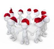 Grupo de personas que celebra en la Navidad Fotos de archivo libres de regalías
