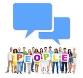 Grupo de personas que detiene a gente de la palabra Imagen de archivo