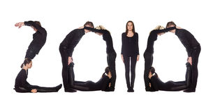 Grupo de personas que forma la palabra ?2010? Foto de archivo libre de regalías