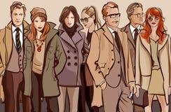 Grupo de personas que se coloca en una fila Fotografía de archivo libre de regalías
