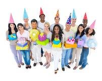 Grupo de pessoas com conceitos da celebração fotografia de stock