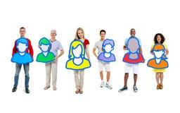 Grupo de pessoas pequeno que guarda avatars Fotografia de Stock Royalty Free