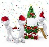 Grupo de pessoas que comemora no Natal Fotografia de Stock Royalty Free