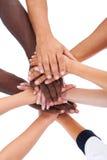 Grupo de pessoas que empilha as mãos junto fotografia de stock