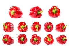 Grupo de pimentas de sino vermelhas isoladas no fundo branco Imagem de Stock Royalty Free