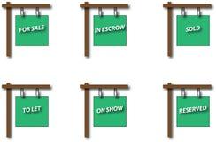 Grupo de placas do sinal de Real Estate fotografia de stock