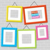 Grupo de quadros da foto em uma parede Fotografia de Stock Royalty Free