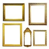 Grupo de quadros dourados. Isolado sobre o fundo branco Fotografia de Stock Royalty Free