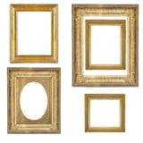 Grupo de quadros dourados isolados no branco Fotos de Stock Royalty Free