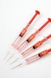Grupo de quatro agulhas vermelhas fotos de stock