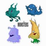 Grupo de quatro bonitos e de monstro colorido dos desenhos animados Fotografia de Stock Royalty Free