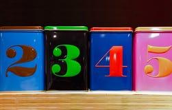 Grupo de quatro caixas coloridas Fotos de Stock Royalty Free