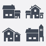 Grupo de quatro casas do vetor Fotografia de Stock