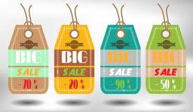 Grupo de quatro coloridos, etiquetas de suspensão com texto Fotografia de Stock Royalty Free