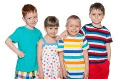 Grupo de quatro crianças alegres fotos de stock