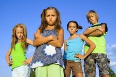 Grupo de quatro miúdos imagem de stock