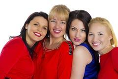 Grupo de quatro 'sexy', mulheres felizes novas bonitas Isolado no whi fotografia de stock