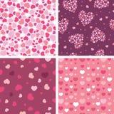 Grupo de quatro testes padrões sem emenda dos corações românticos Imagens de Stock
