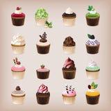 Grupo de 16 queques deliciosos Fotos de Stock Royalty Free