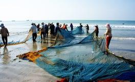 Grupo de red del tirón del pescador Fotografía de archivo