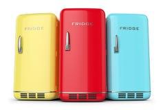 Grupo de refrigeradores coloreados retros en fila Imagen de archivo libre de regalías