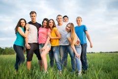 Grupo de risa feliz de la gente joven Fotos de archivo