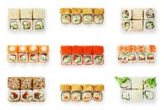 Grupo de rolos de sushi isolados no branco Fotografia de Stock Royalty Free