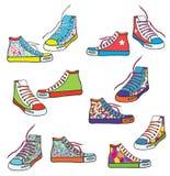 Grupo de sapatilhas com o teste padrão engraçado Fotos de Stock Royalty Free