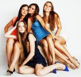 Grupo de señoras elegantes diversas en los vestidos brillantes aislados en wh Foto de archivo libre de regalías