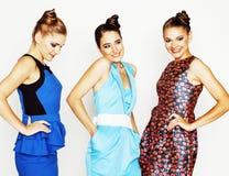 Grupo de señoras elegantes diversas en los vestidos brillantes aislados en wh Imagen de archivo libre de regalías