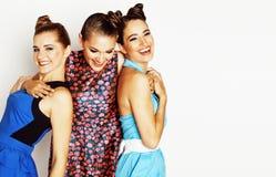 Grupo de señoras elegantes diversas en los vestidos brillantes aislados en wh Fotografía de archivo libre de regalías