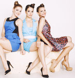 Grupo de señoras elegantes diversas en vestidos brillantes Imágenes de archivo libres de regalías