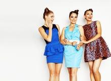 Grupo de señoras elegantes diversas en vestidos brillantes en wh Fotografía de archivo libre de regalías