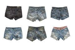 Grupo de short da sarja de Nimes para a fêmea isolada no fundo branco imagem de stock
