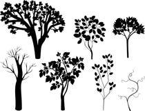 Grupo de silhuetas diferentes das árvores ilustração do vetor