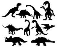 Grupo de silhuetas dos dinossauros ilustração royalty free