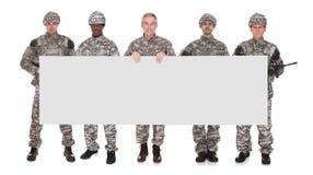 Grupo de soldado With Placard imagens de stock royalty free