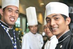 Grupo de sorriso do cozinheiro chefe Fotografia de Stock